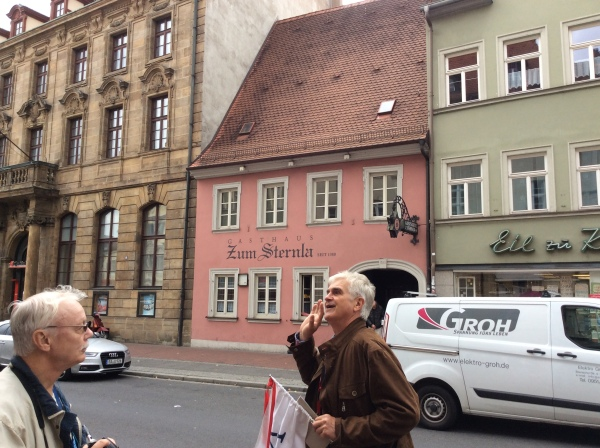 Tour guide pointing out the Gasthaus zum Sternla, 10-21-14