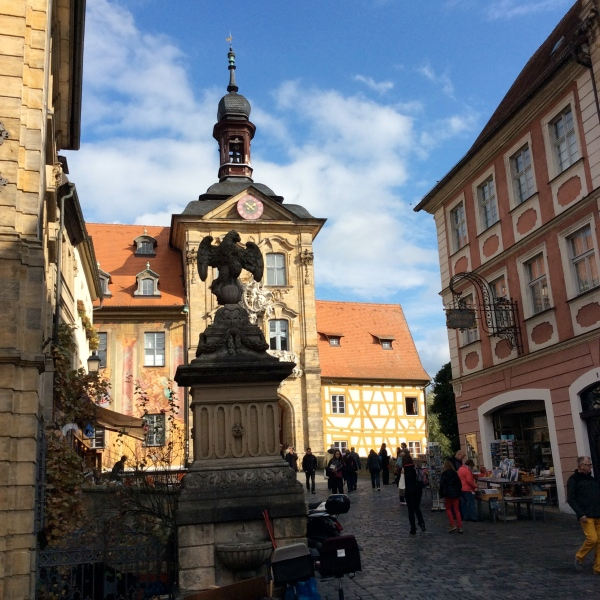 Walking toward the Altes Rathaus, past a medieval eagle statue