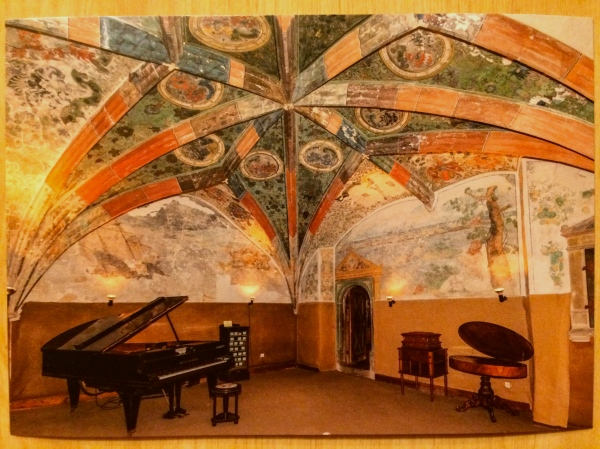 "The ""Ahnensaal"" (antechamber) with a player grand piano (postcard)"