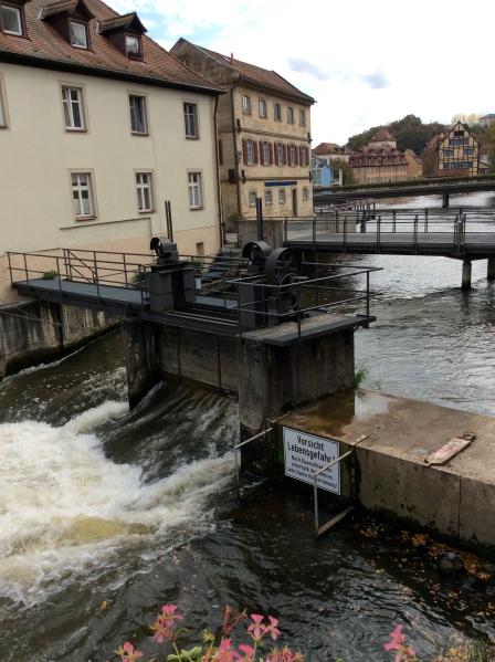 A small dam behind the bridge