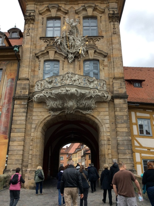 Walking up to the archway in the Altes Rathaus: Bill G., Lois, Dom, & Sam, 10-21-14