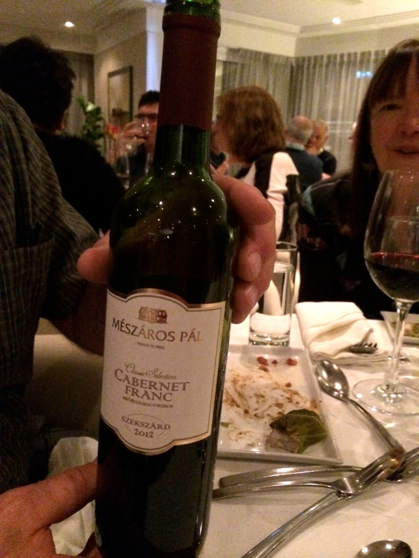 Bill reading the wine label, Lois looking on, 10-22-14