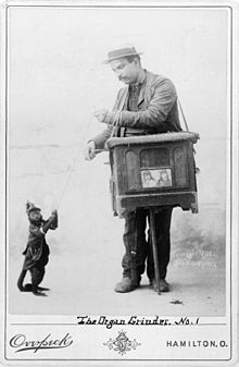 Organ grinder with monkey, 1892 (from Wikipedia)