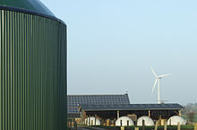 Biogas fermenter, wind turbine and solar panels in Horstedt, Schleswig-Holstein (photo from Wikipedia)