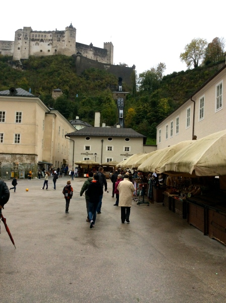 Walking toward the Hohensalzburg Castle, with a view of the tram carrying people up the hill, 10-24-14