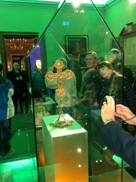 """Bill and Lois looking at the Abbey's sacred cross that holds the """"splinter"""" of Jesus' cross inside it (10-25-14)"""