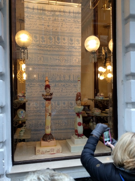 Beautiful cakes in Café Demel's side window, Susan taking a photo (10-26-14)